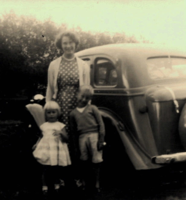 Mum and sister Anne beside dads Vauxhall 14 that we had while living in Witney