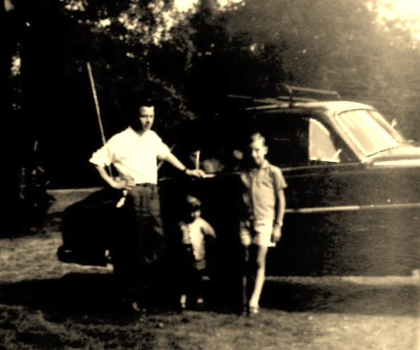 Dad and brother Chris, beside the familys Vauxhall Velox that we went to Brafield in.
