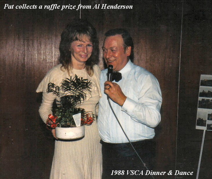 Pat collects her luck draw prize from Al Henderson